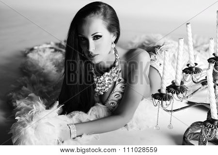 Beautiful Woman In White Stage Costume With Bling-bling And Candelabrum Near