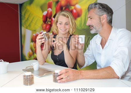 Man and lady testing coffee