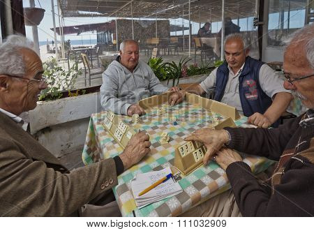 Turkish Men Playing Rummy Tile Game Near The Seaside
