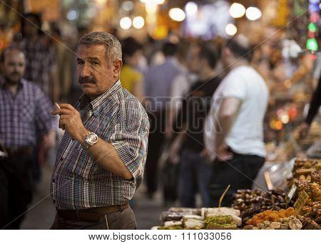 Vendor Smoking In Istanbul Spice Market