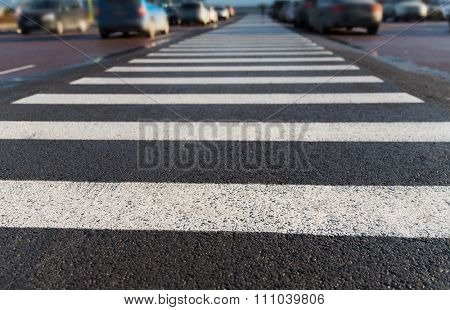 safety, traffic laws, highway code and road sign concept - close up of pedestrian crosswalk on city car parking