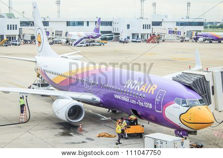 Air plan Air asia,Thai smile , Nok air parking on runway and preparing to flying at Don Mueang air p