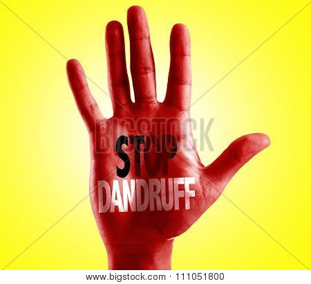 Stop Dandruff written on hand with yellow background