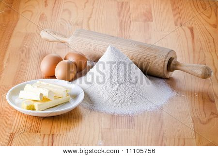 Flour With Eggs, Rolling Pin And Butter