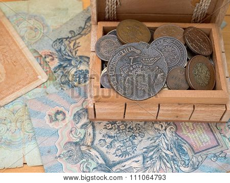 The Hoard Of Old Coins In A Wooden Box