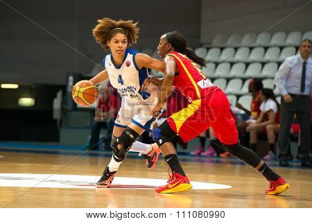 MOSCOW -- DECEMBER 4, 2014: Katerina Keyru (4) dribble on the International Europe bascketball league match Dynamo Moscow vs Maccabi Ashdod Israel in sport palace Krilatskoe, Moscow, Russia. Dynamo loss 59:67