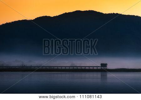 Natural landscape view at Bang-Pra lake with mist in morning, Thailand.