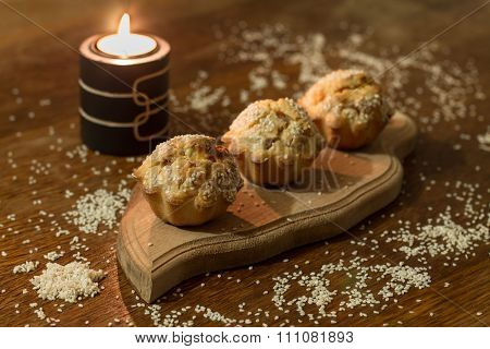 Three salty muffins with sausage, cheese and sesame
