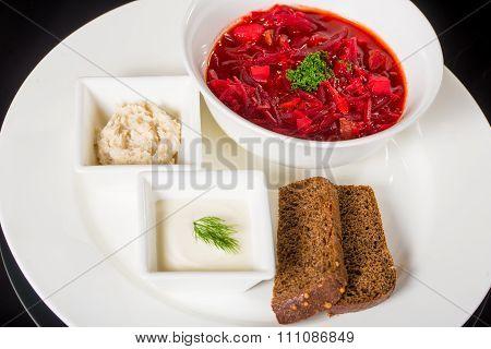 Borsch with creme fraiche, lard and bread