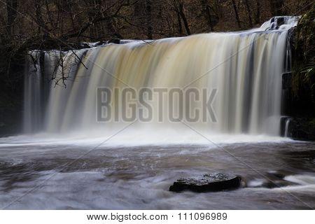 Sgwd Ddwli Uchaf Falls waterfall. Pontneddfechan Vale of Neath Powys Wales United Kingdom winter. poster