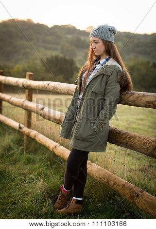 Beautiful Teen Girl Leaning Against A Farm Fence