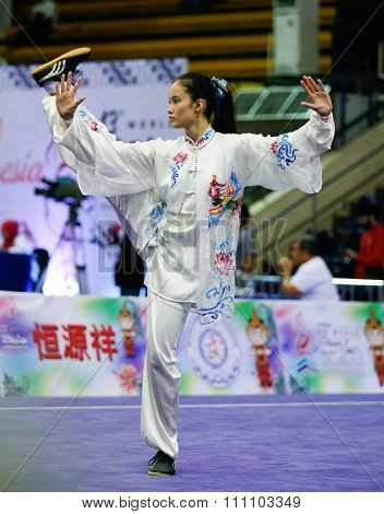 JAKARTA, INDONESIA - NOVEMBER 16, 2015: Agatha Wong from the Philippines performs her movements in the Women's Compulsory Taijiquan event at the 13th World Wushu Championship 2015.
