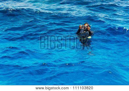 Scuba Diver With Underwater Camera