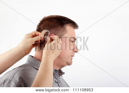 Helping In Inserting Hearing Aid