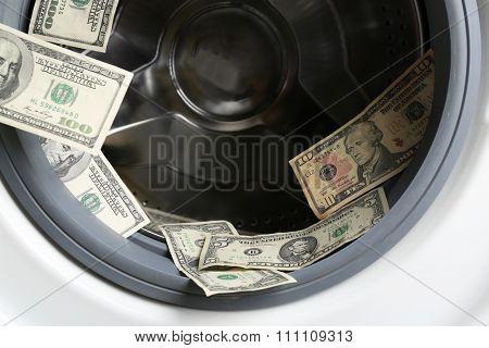 Money in washing machine, close up