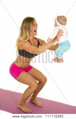 Woman In Fitness Attire Squat With Baby