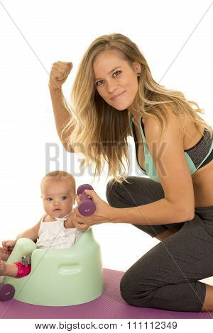 Woman In Fitness Attire With Baby Flex