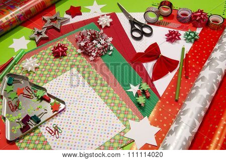 Colorful wrapping paper rolls pencils different washi tapes craft scissors. Wrapping Christmas gifts in colorful paper. poster