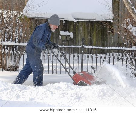 Man Using Snow Blower