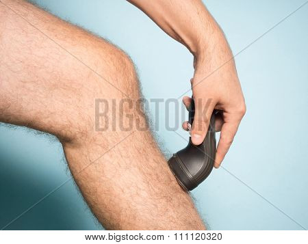 Caucasian Man Shaving Hair From Legs