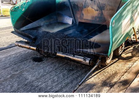 Pavement Mashine Laying Fresh Asphalt On The Top Of The Gravel Base During Road Construction