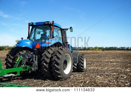 Tractor With Plow Working In The Field