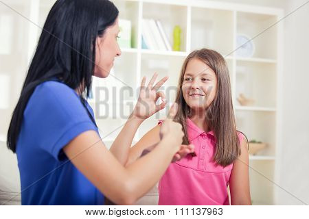 Smiling deaf girl learning sign language