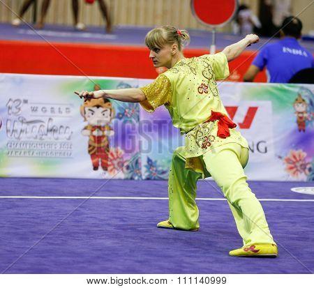 JAKARTA, INDONESIA - NOVEMBER 16, 2015: Tetyana Kondratyeva of Ukraine performs her movements in the Women's Compulsory Nanquan event at the 13th World Wushu Championship 2015 in Istora Senayan.