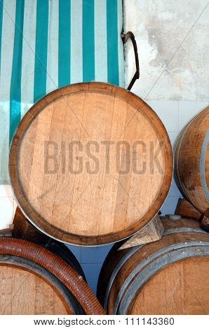 Background Perspective Inside A Winecellar Full Of Wooden Barrels
