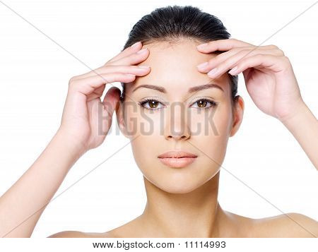 Woman Touching Her Forehead Without Wrinkle