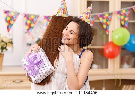 Birthday girl hugging her friend.