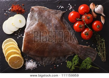 Raw Plaice With Ingredients On A Slate Board Closeup. Horizontal Top View