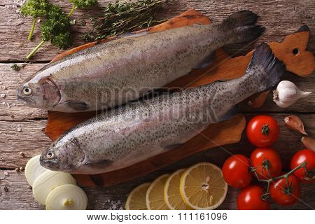 Raw Trout With Ingredients On A Table Close-up. Horizontal Top View