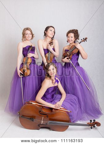 Musical Quartet In Evening Dresses