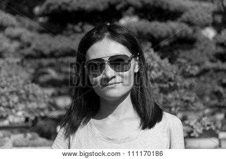 Asian Woman With Blurred Bonsai Tree Background