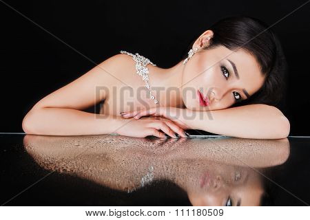 beautiful young asian woman wearing luxurious necklace