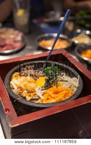 Korean Bibimbap Served On Traditional Hot Stone