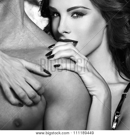 Sexy woman embrace naked man shoulder black and white bdsm poster