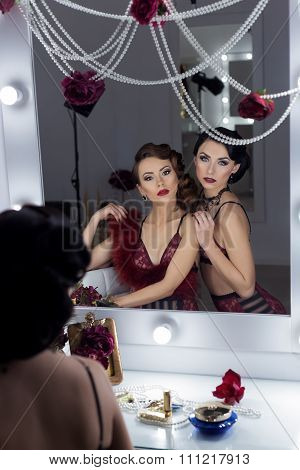 an elegant sexy beautiful young girls with bright makeup in retro style in Lacy red lingerie, look