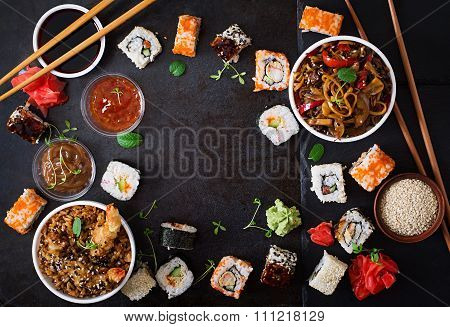 Traditional Japanese Food - Sushi, Rolls, Rice With Shrimp And Udon Noodles With Chicken And Mushroo
