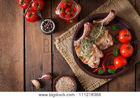 Grilled Juicy Steak On The Bone With Vegetables On A Wooden Background. Top View