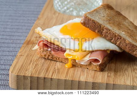 Wholemeal sandwich with fried egg, ham and cheese.