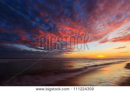 Beautiful Colored Clouds At The Beach At Sunset