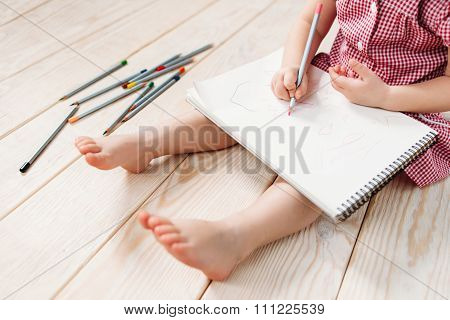 Little Girl Drawing With Colorful Pencils