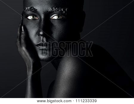 Woman With A Painted Black Skin And Crystals On The Brows. Black Image