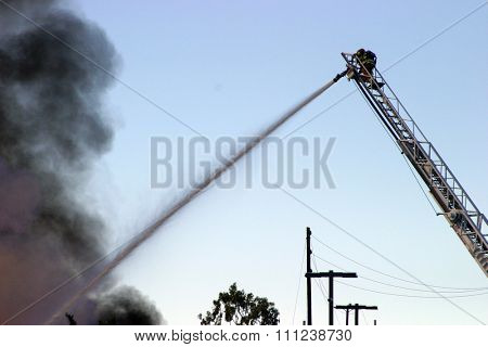 HARBOR GATEWAY, CALIFORNIA- DECEMBER 12, 2015: Fire erupts at recycling yard in Harbor Gateway. Dozens of Fire Trucks arrive to help extinguish an industrial fire, California Dec. 12, 2015