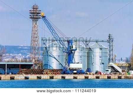 Grain Elevator in the Port. Steel Grain Bins. poster