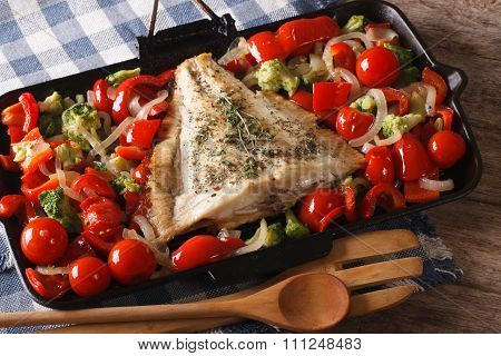 Flatfish With Vegetables Close-up On A Frying Pan. Horizontal
