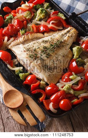 Flatfish With Vegetables Close-up On A Frying Pan. Vertical