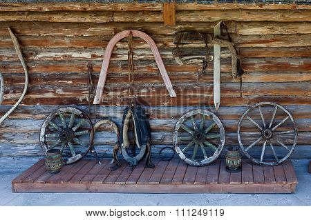 Log Wall With Parts Of Old Carts